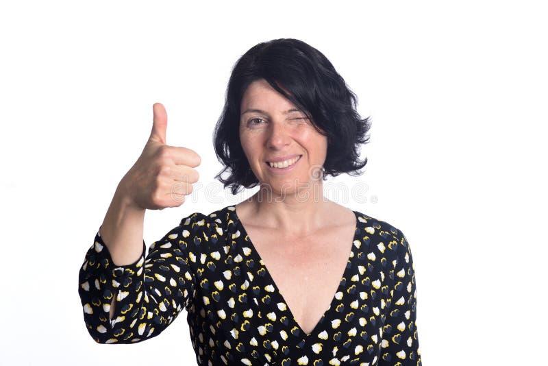 Vrouw met tumbs omhoog op wit royalty-vrije stock afbeeldingen