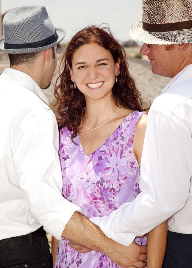 Vrouw met Twee Mannen stock afbeelding