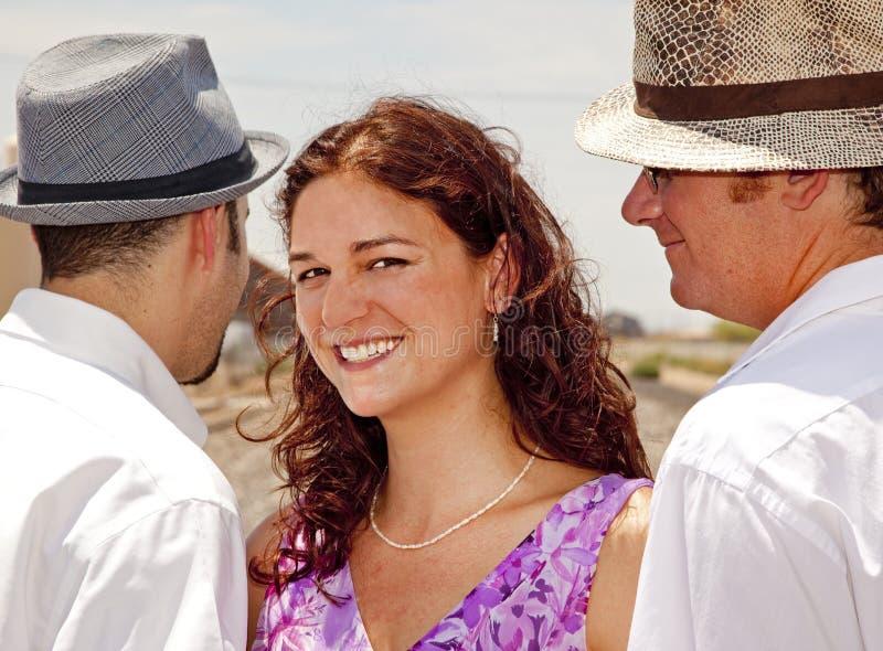 Vrouw met Twee Mannen stock afbeeldingen