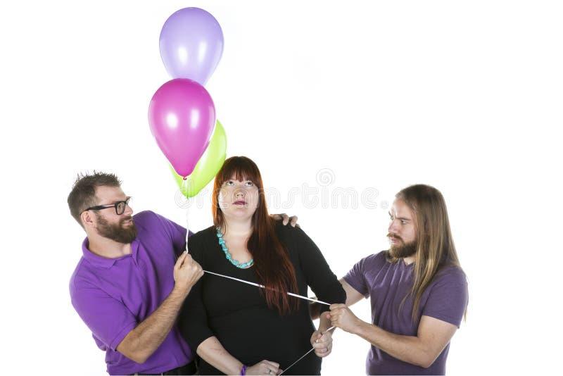 Vrouw met Twee Mannen stock fotografie