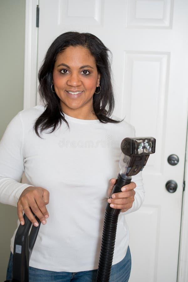 Vrouw met Vacuüm royalty-vrije stock afbeelding