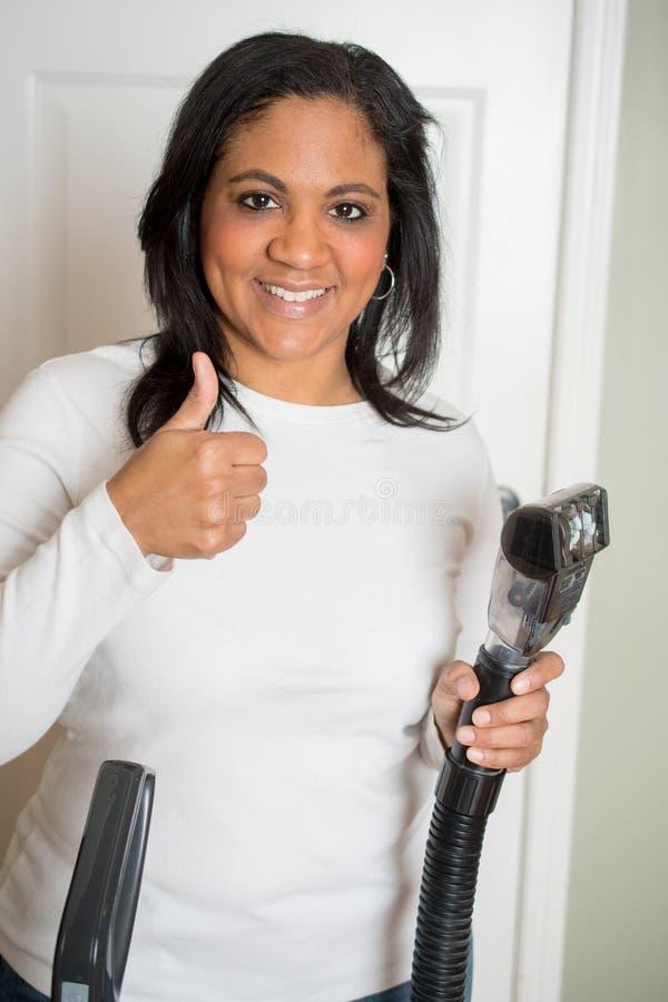 Vrouw met Vacuüm stock afbeelding