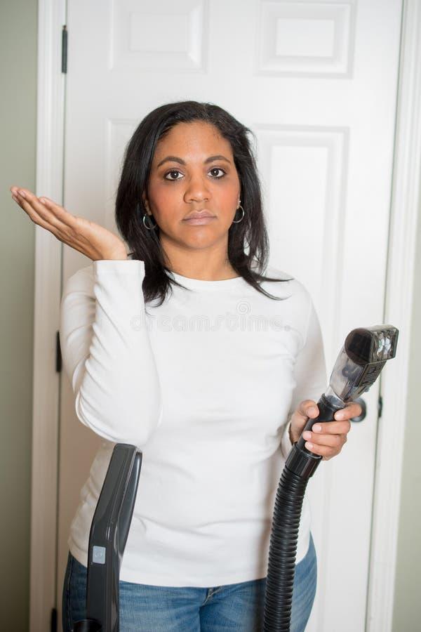 Vrouw met Vacuüm stock foto