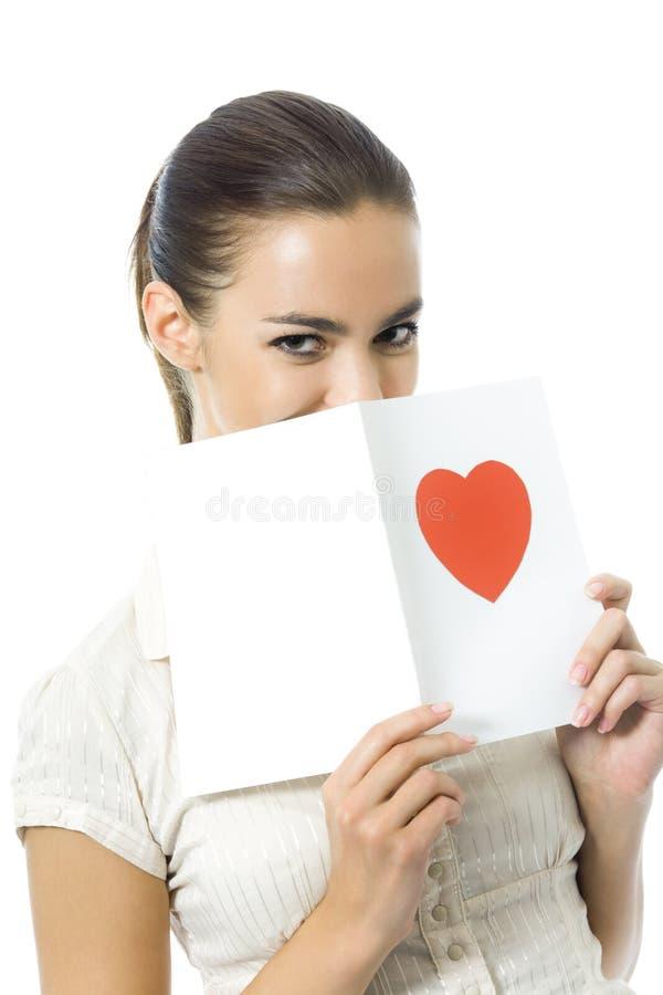 Vrouw met valentijnskaartkaart stock afbeelding