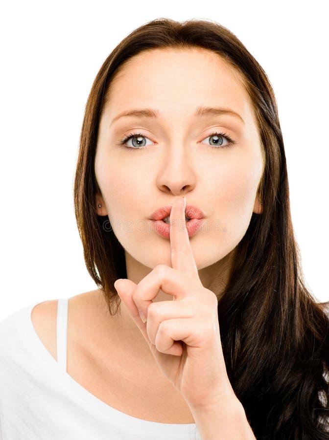 Vrouw met vinger op lippenclose-up op witte achtergrond wordt geïsoleerd die royalty-vrije stock fotografie