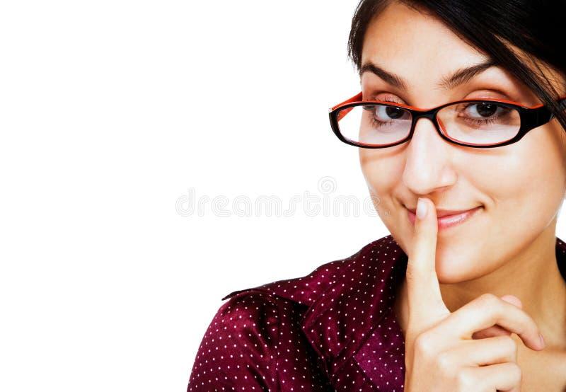 Vrouw met vinger op mond royalty-vrije stock foto's
