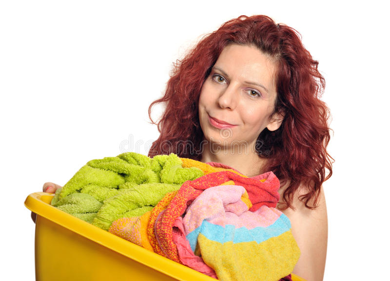 Vrouw met wasserij stock afbeelding
