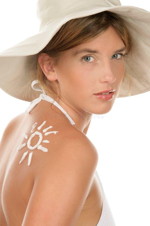 Vrouw met zonnebrandolie royalty-vrije stock foto's