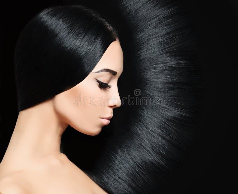Vrouw met zwart haar Het kapsel van de manier stock foto
