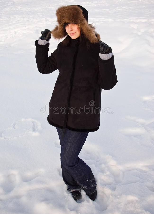Vrouw in oor-klep stock fotografie