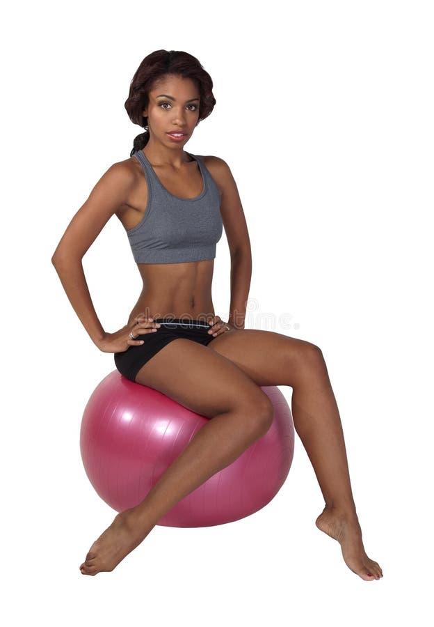 Vrouw op bal met het knippen van weg royalty-vrije stock foto