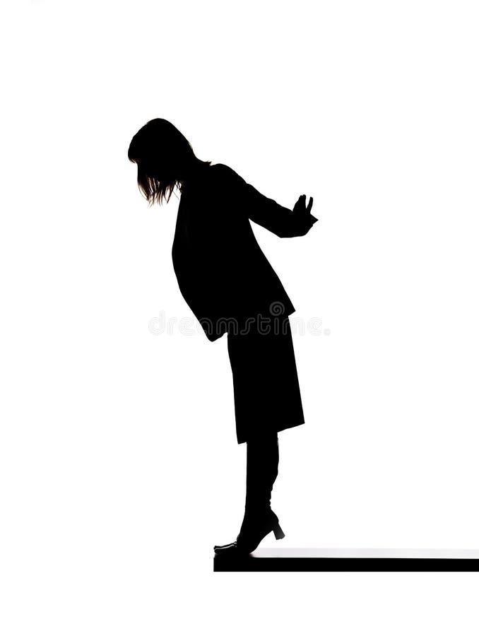 Vrouw op de rand stock afbeelding