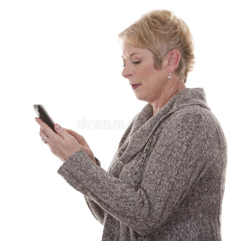Vrouw op de telefoon stock foto's