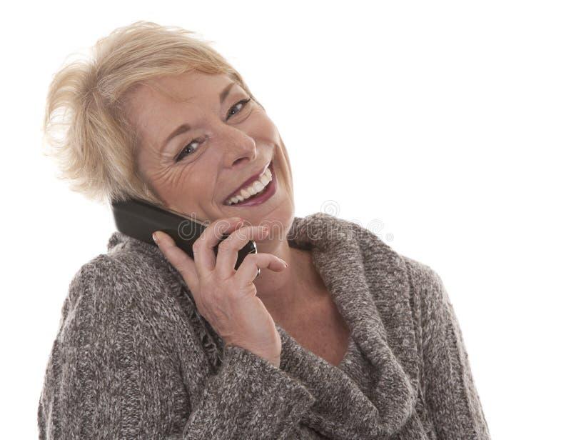 Vrouw op de telefoon stock fotografie