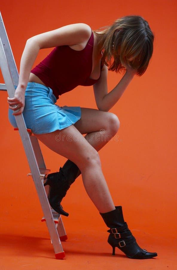 Vrouw op Ladder 3 royalty-vrije stock afbeelding