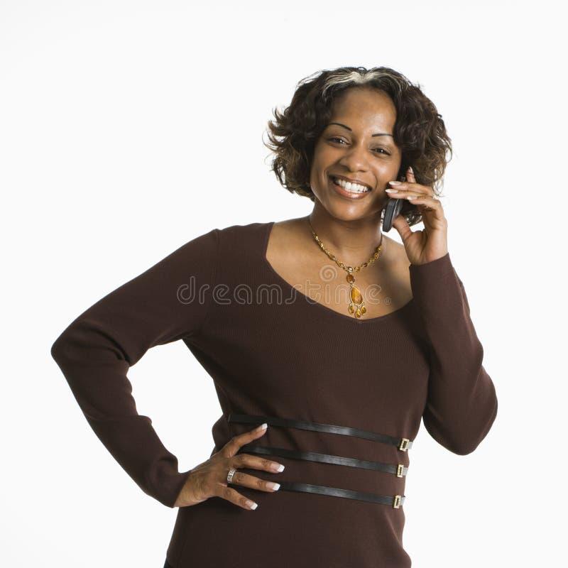 Vrouw op telefoon. stock fotografie