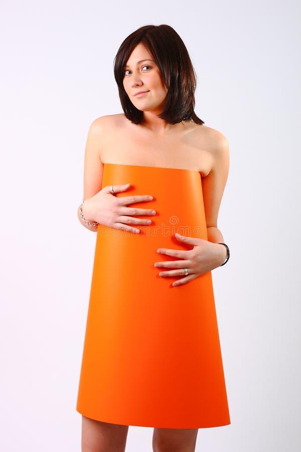 Vrouw in oranje kleding royalty-vrije stock afbeelding