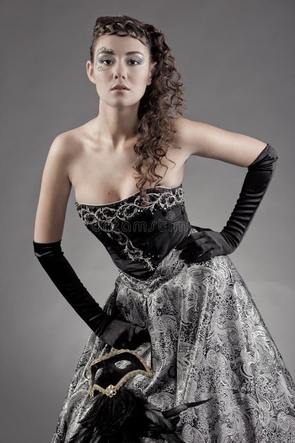 Vrouw in oude stijl stock foto