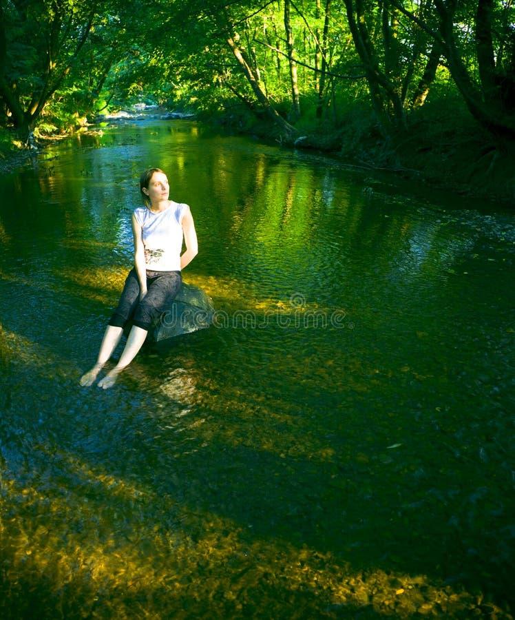 Vrouw in rivier royalty-vrije stock foto