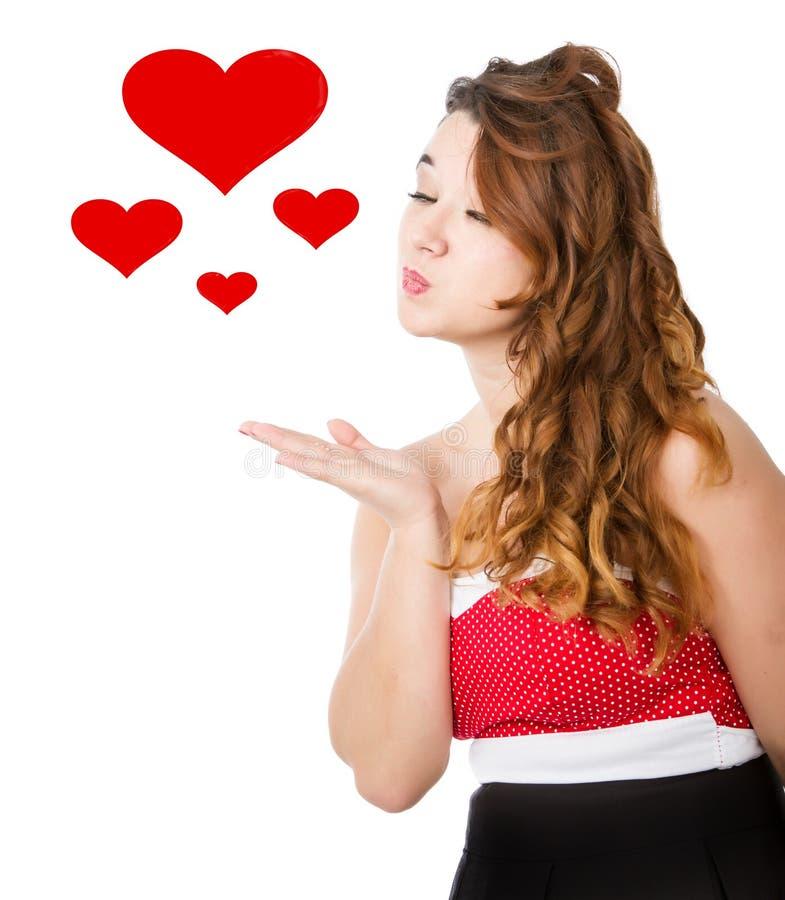 Vrouw in rode kledings blazende kussen stock foto