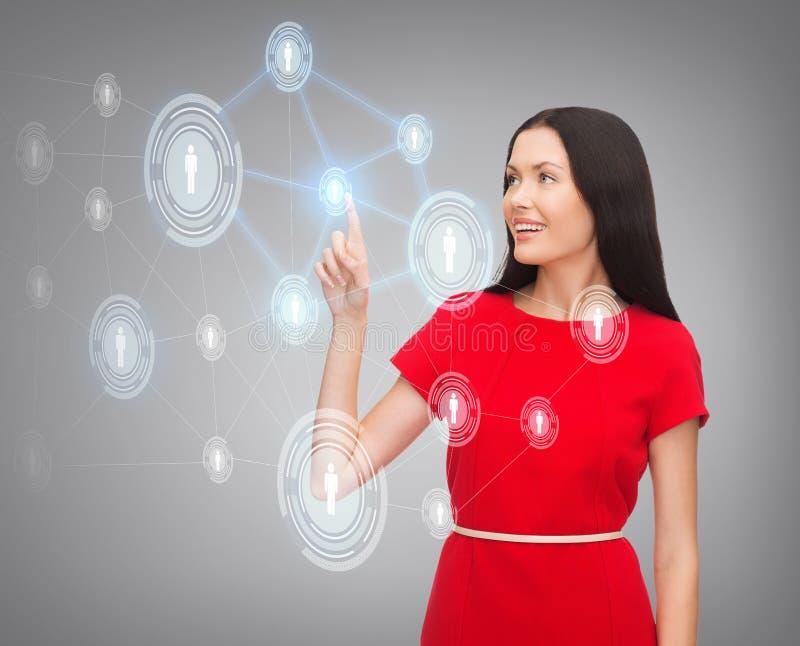 Vrouw in rood kledings en bedrijfsnetwerk royalty-vrije stock foto's