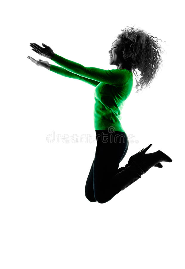 Vrouw silhouet het geïsoleerde gelukkig springen royalty-vrije stock afbeeldingen