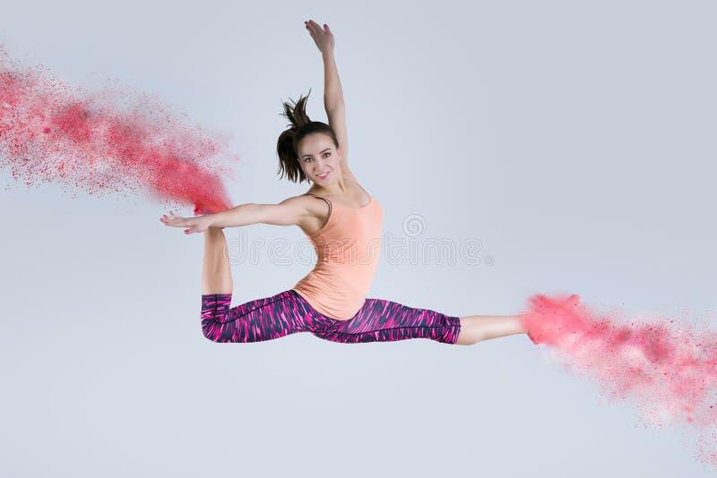 Vrouw in sprong Bevroren motie stock fotografie
