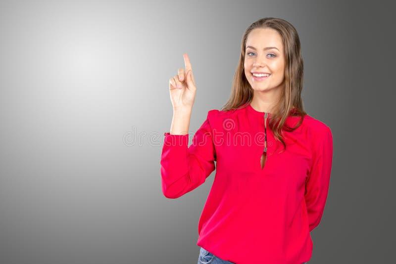 Vrouw status die haar vinger richten royalty-vrije stock foto