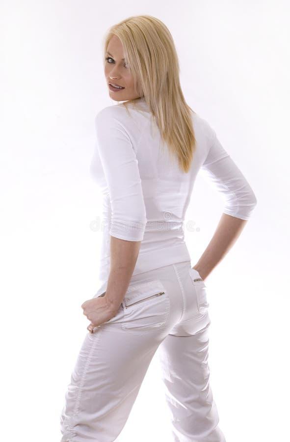 Vrouw in wit stock fotografie