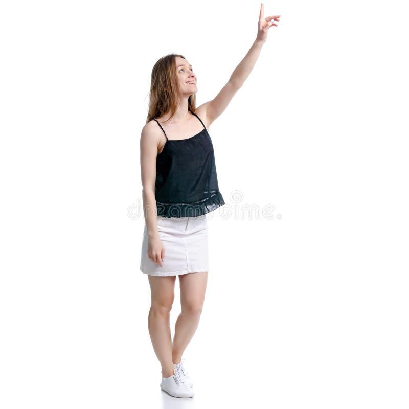 Vrouw in witte rok en zwarte die het richten tonen stock fotografie
