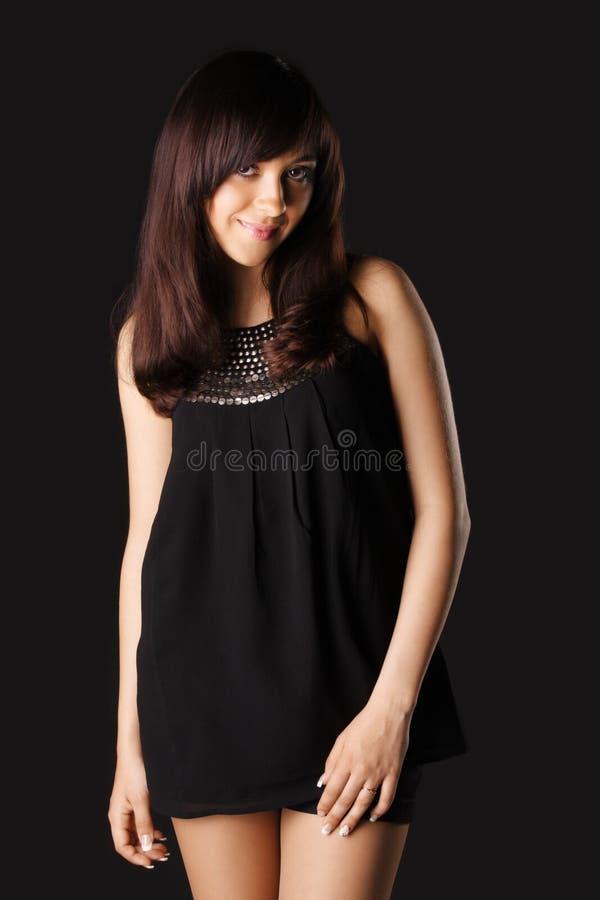 Vrouw in zwarte blouse royalty-vrije stock foto