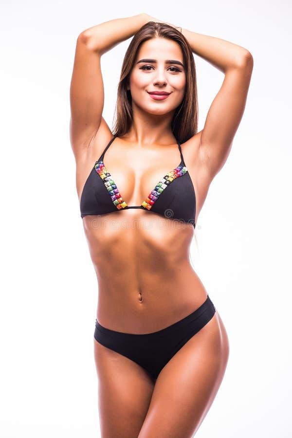 Vrouw in zwempak met perfecte abs stock afbeeldingen