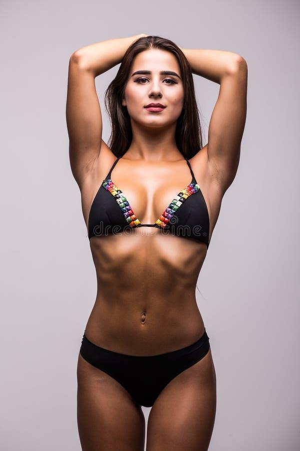 Vrouw in zwempak met perfecte abs royalty-vrije stock afbeelding