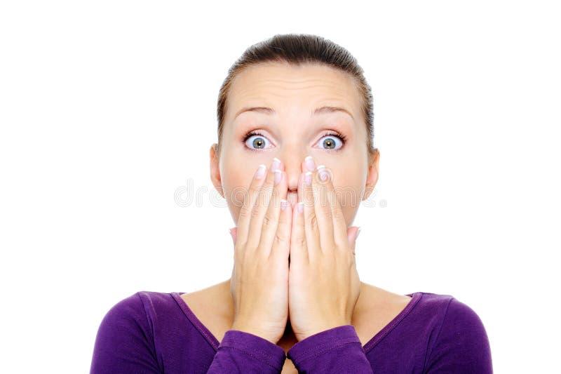 Vrouwelijk gezicht met heldere verrassingsemotie stock foto