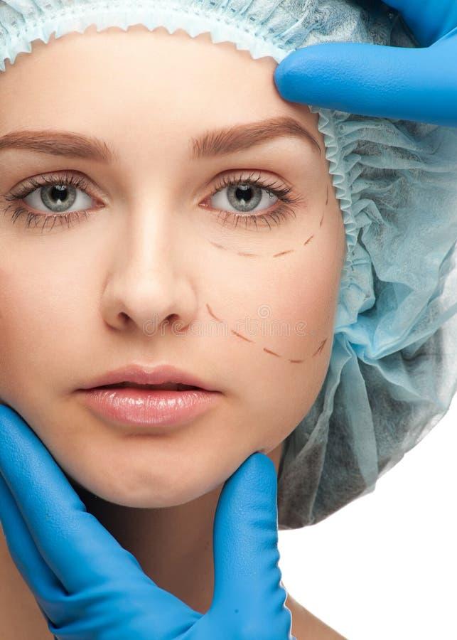 Vrouwelijk gezicht vóór plastische chirurgieverrichting royalty-vrije stock afbeelding