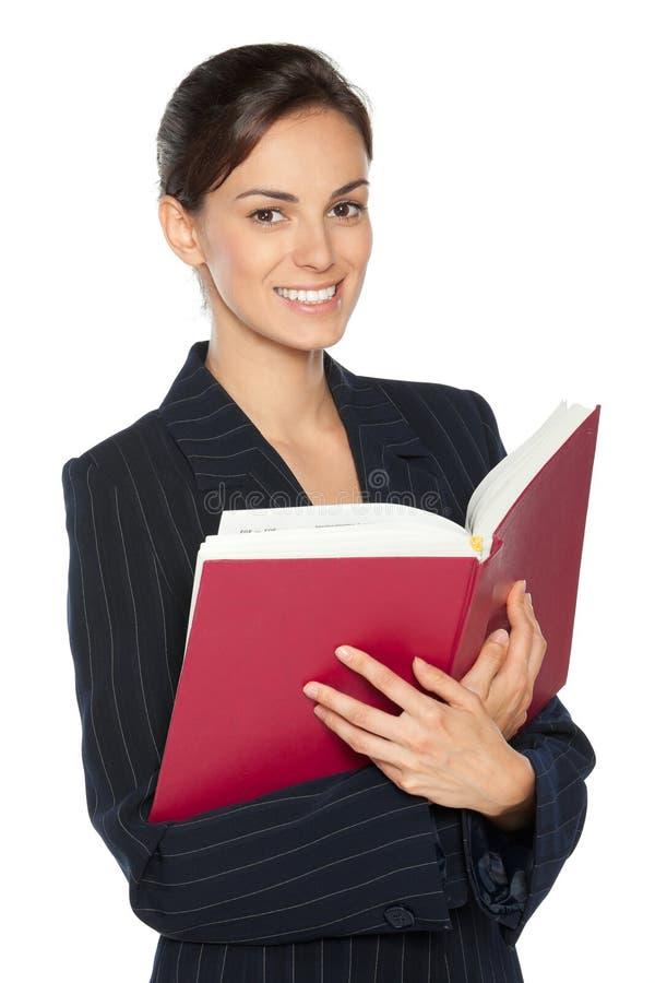 Vrouwelijk holdingsboek stock foto