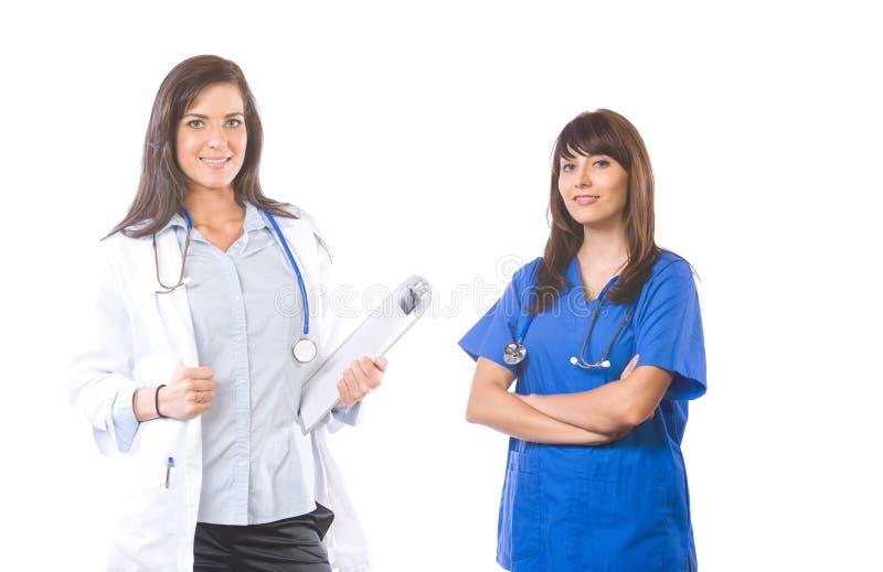 Vrouwelijk medisch team dat op wit wordt geïsoleerdr royalty-vrije stock foto's