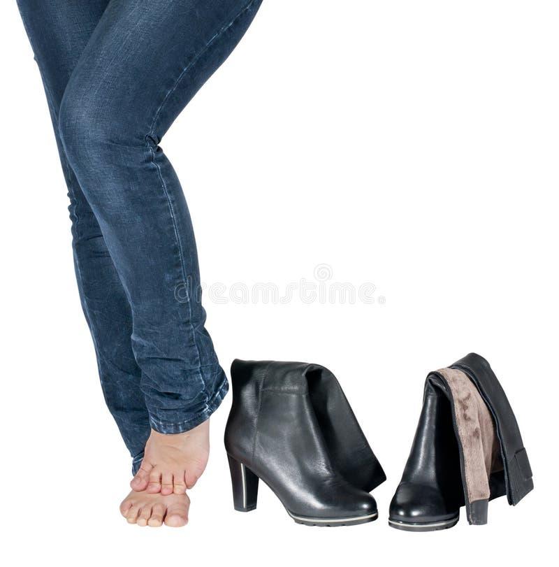 Vrouwelijke benen en laarzen stock foto