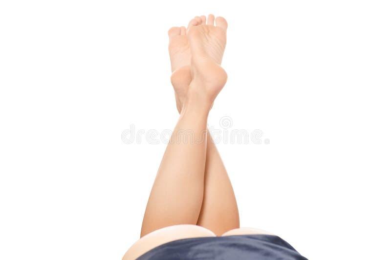Vrouwelijke benen gezien ezel stock afbeeldingen