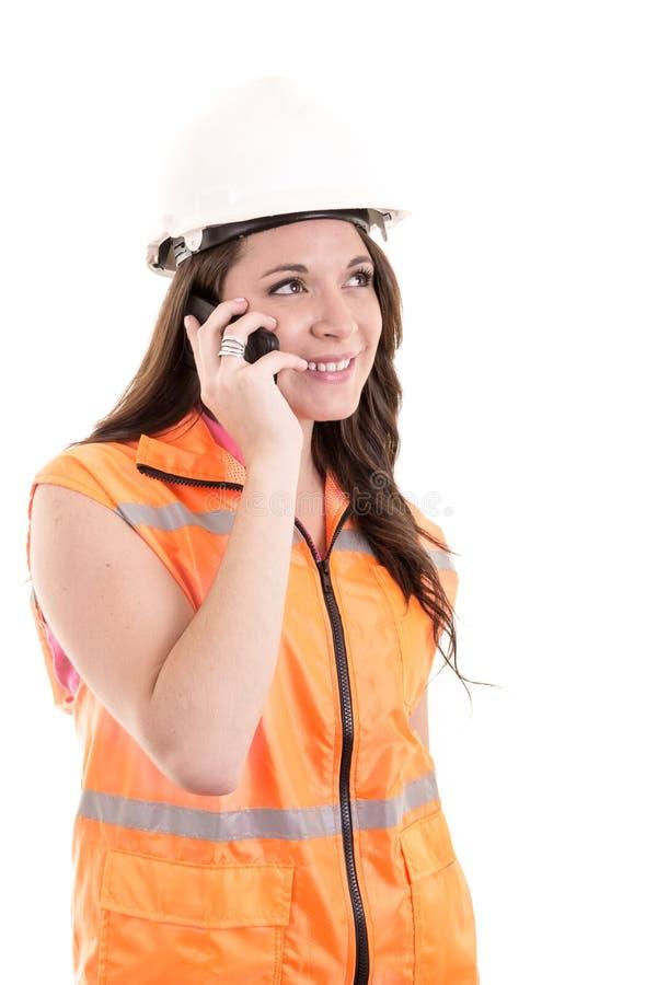 Vrouwelijke bouwvakker of ingenieur met hard royalty-vrije stock afbeelding