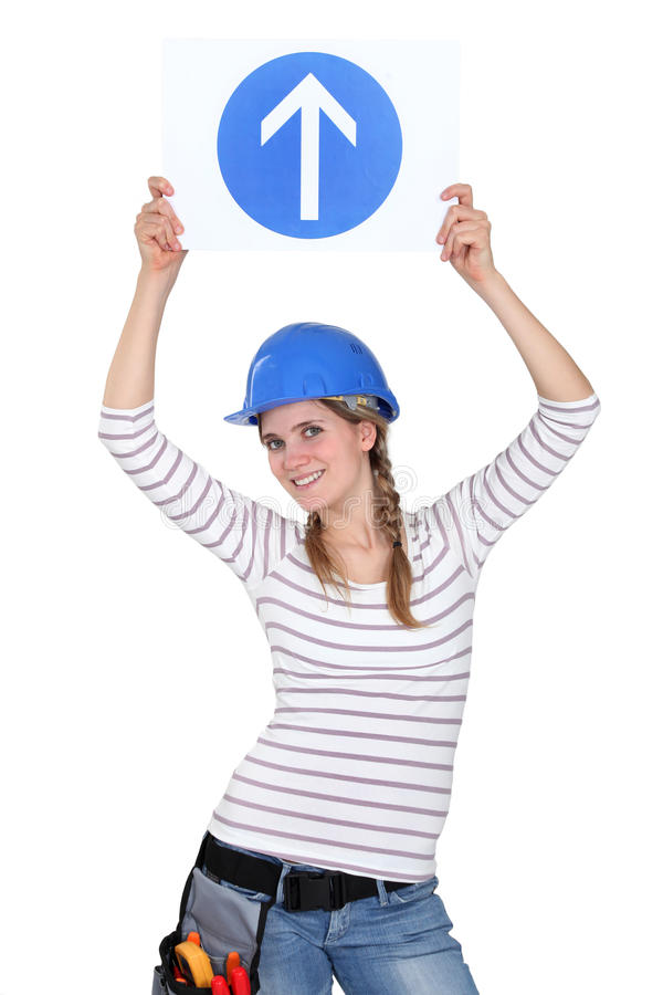 Vrouwelijke bouwvakker met teken royalty-vrije stock afbeelding