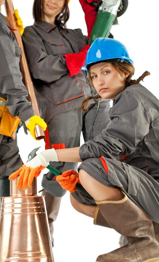 Vrouwelijke bouwvakkers stock foto's