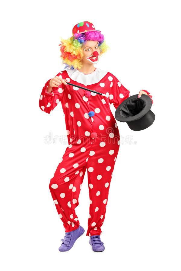 Vrouwelijke clown die een tovenaarhoed houden royalty-vrije stock foto