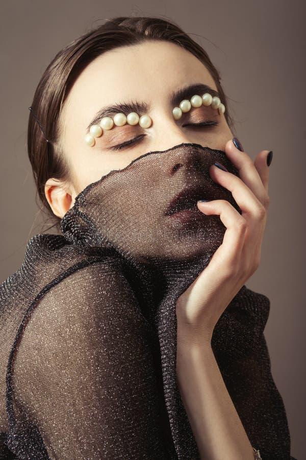 Vrouwelijke creatieve make-up stock afbeeldingen