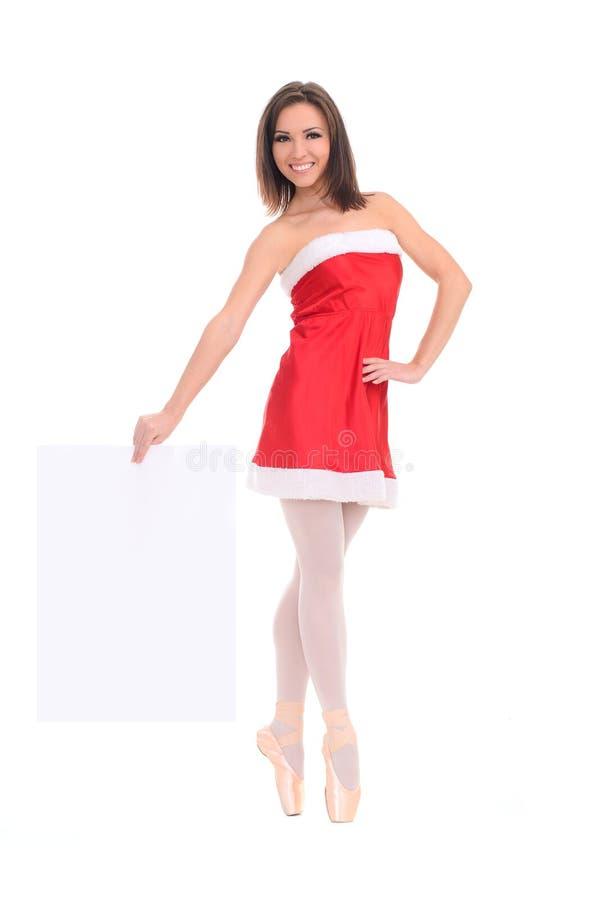 Vrouwelijke danser in nieuwe jaarkleding met banner royalty-vrije stock afbeeldingen
