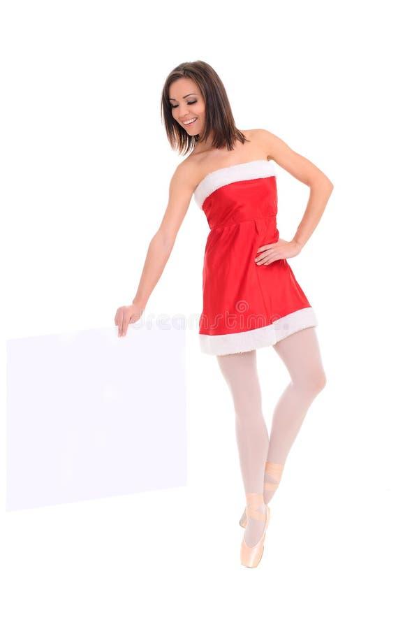 Vrouwelijke danser in nieuwe jaarkleding met banner stock afbeelding