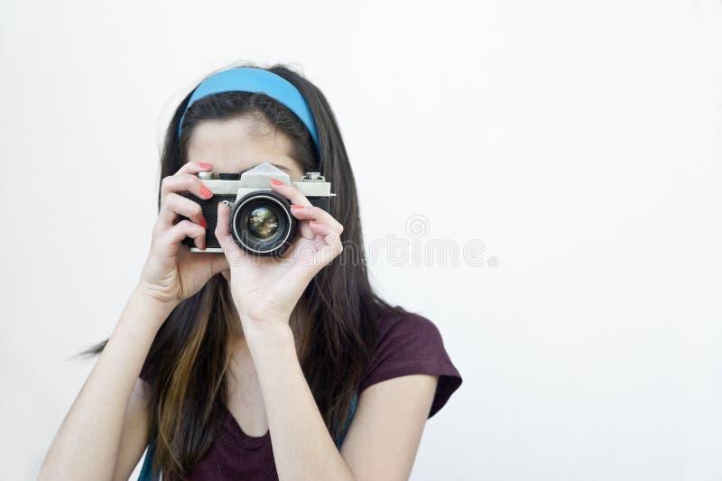 Vrouwelijke fotograaf die schoten nemen royalty-vrije stock foto