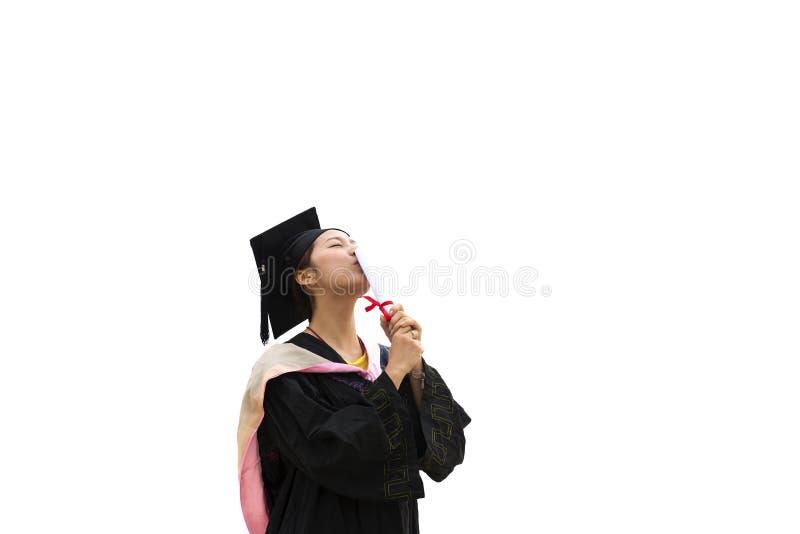 Vrouwelijke gediplomeerde dragende graduatietoga royalty-vrije stock fotografie