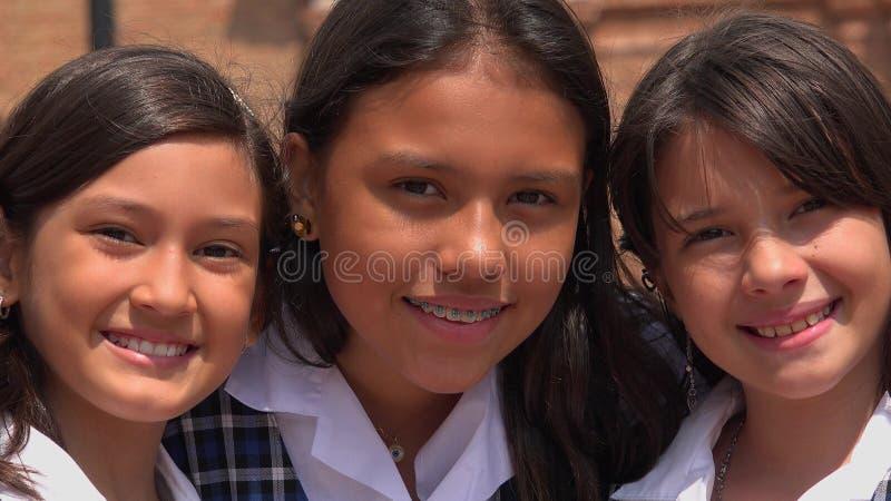 Vrouwelijke Gelukkig en Kinderen die glimlachen royalty-vrije stock foto