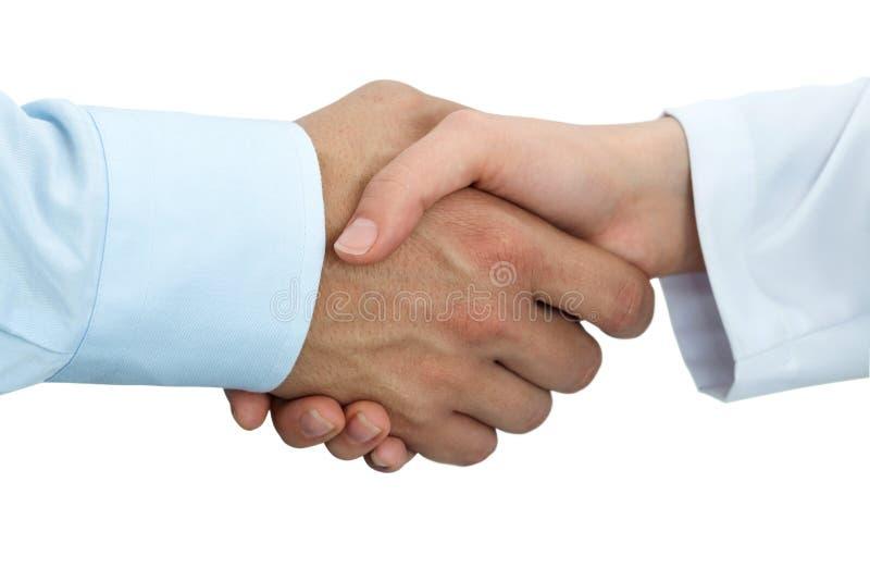 Vrouwelijke geneeskunde arts het schudden handen met mannelijke patiënt stock foto